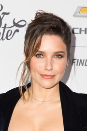 Sophia Bush looked romantic and elegant wearing this loose bun with wavy tendrils at the Create & Cultivate 100 event.