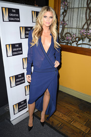 AnnaLynne McCord was bold and sexy in a plunging blue wrap dress at the Creative Coalition Spotlight Initiative Awards.