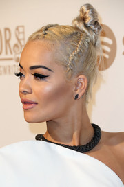 Rita Ora looked funky wearing this braided top knot at the Creators party.