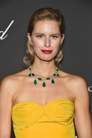 Karolina Kurkova added more color with an emerald statement necklace by Chopard.