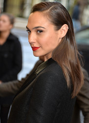 Gal Gadot opted for a simple straight 'do with a slicked-down top when she attended the UK premiere of 'Criminal.'