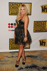 Lacey Schwimmer hit the Critics Choice Awards in a metallic Marco Marco dress paired with black T-strap platforms with crisscrossing straps.