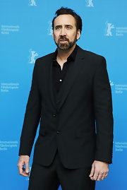 Nicholas Cage sported an all-black suit for a sophisticated and put-together look.