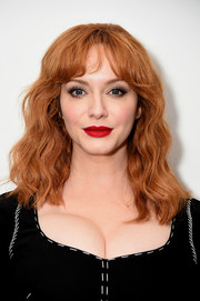 Christina Hendricks looked sweet with her shoulder-length waves and parted bangs at the New York premiere of 'Crooked House.'