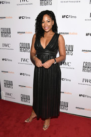 Natalie Paul was sexy-glam in a plunging black empire-waist gown at the New York premiere of 'Crown Heights.'
