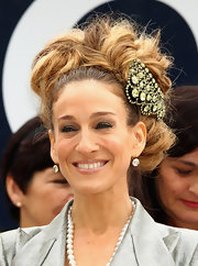 Sarah Jessica Parker went all out for a day at the races. Her voluminous 'do consisted of loops, swirls and lots of bobby-pinned curls. Don't forget the addition of her sparkly jeweled accent.