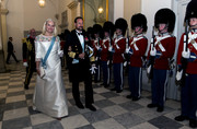 Princess Mette-Marit looked stunning in a white gown with an embellished yoke at the gala banquet to celebrate the Crown Prince's 50th birthday.
