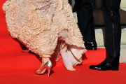 The princess paired her couture gown with metallic evening pumps.