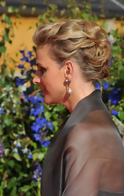 Charlene wore an intricate, textured updo with pearl drop earrings.