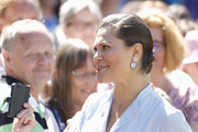 Princess Victoria finished off her look with a pair of dangling diamond earrings.