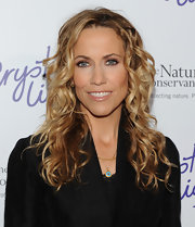 Sheryl Crow's hair looks gorgeous in pretty curls.