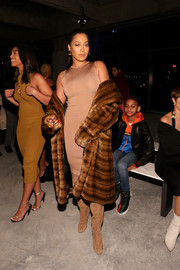 La La Anthony kept warm in ultra-glam style with a brown fur coat.