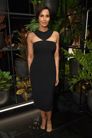 Padma Lakshmi was modern and sexy in a fitted black halter dress by Cushnie et Ochs during the label's Spring 2018 show.