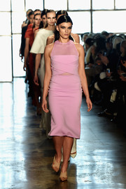 A pair of two-tone cross-strap pumps finished off Crystal Renn's runway look.