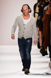 A simple cardigan finished off Custo Dalmau's casual look as he walked down the catwalk after his own runway show.