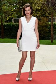 Milla Jovovich styled her dress with a pair of black-and-white striped pumps.