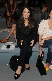 Kimberly Guilfoyle completed her all-black ensemble at the Cynthia Rowley fashion show with a pair of black platform peep-toes.