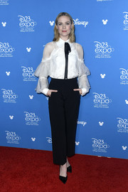 Evan Rachel Wood paired her top with cropped black trousers.
