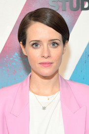 Claire Foy wore her hair in a neat side-parted style while visiting DIRECTV House.