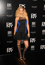 Rita stuck to a cool and contemporary look with this black and blue fit-and-flare frock.