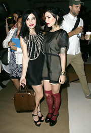 Lisa Origliasso showed some leg by wearing a short dress with sequin detailing at the DKNY fashion show.