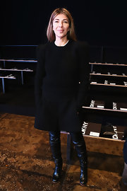 Nina Garcia looked snug in her sweater and thigh-high boots at the DKNY Fall 2013 fashion show.