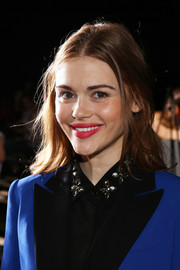 Holland Roden went for simple styling with this center-parted 'do when she attended the DKNY fashion show.