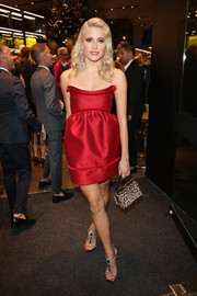 Pixie Lott wore bejeweled T-strap sandals with her dress for an extra dose of sophistication.