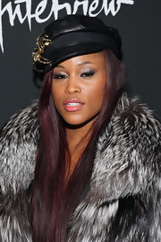 Eve wore a black leather newsboy cap with her fur coat for a more dramatic look during the 'Behind the Mirror' premiere.