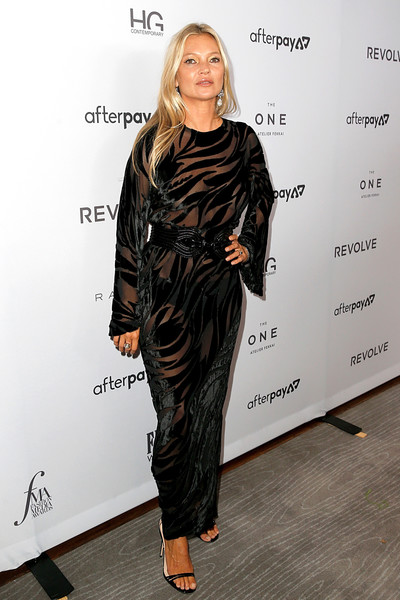 Kate Moss complemented her gown with strappy black heels.