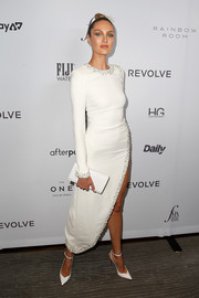 A simple leather clutch finished off Candice Swanepoel's all-white ensemble.