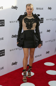 Fergie chose a two-tone ruffle-embellished mini dress by Dsquared2 for the Fashion Los Angeles Awards.