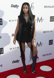 Nicki Minaj donned a tailored look by Versace (but opted to ditch the trousers) for the Fashion Los Angeles Awards.