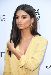 Emily Ratajkowski paired her yellow dress with dangling jade earrings by David Webb at the 2018 Fashion Los Angeles Awards.