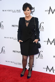 Kris Jenner styled her LBD with a pair of midnight-blue satin pumps.