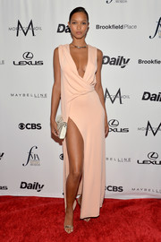 Lais Ribeiro styled her dress with gold slingbacks.
