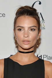 Emily Ratajkowski worked a retro bun at the Fashion Media Awards.