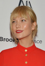 Karlie Kloss sported a loose bun with eye-grazing bangs at the Fashion Media Awards.