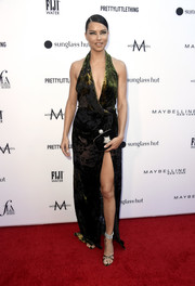 Adriana Lima sizzled in a plunging halter gown by Oscar de la Renta at the 2019 Fashion Los Angeles Awards.