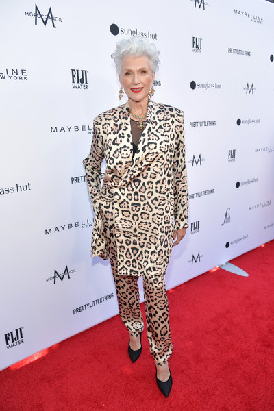 Maye Musk walked on the wild side in a leopard-print satin suit by Baja East at the 2019 Fashion Los Angeles Awards.