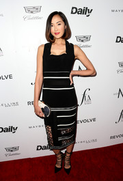 Chriselle Lim donned a black midi dress with satin stripes and a see-through hem for the Fashion Los Angeles Awards.