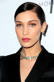 Bella Hadid added color with a glossy pink lip.