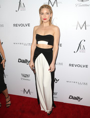 Kate Hudson matched her sexy top with a pair of black-and-white silk pants, also by August Getty Atelier.