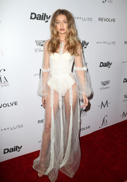 Underneath her gown, Gigi Hadid wore a sexy white bodysuit by La Perla.