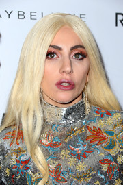 Lady Gaga sported a heavy application of coral eyeshadow for a bold beauty look.