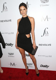 Alessandra Ambrosio flashed lots of skin in this Anthony Vaccarello asymmetrical cutout LBD at the Fashion Los Angeles Awards.