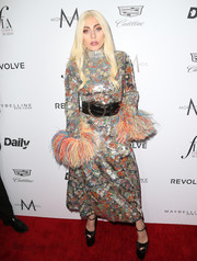 Lady Gaga completed her outfit with her signature sky-high platforms.