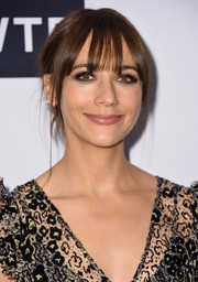 Rashida Jones attended the Daily Front Row's Fashion Media Awards wearing a slightly messy, loose updo.