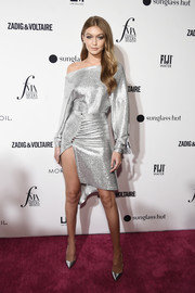 Gigi Hadid matched her top with a high-slit silver skirt, also by Paco Rabanne.