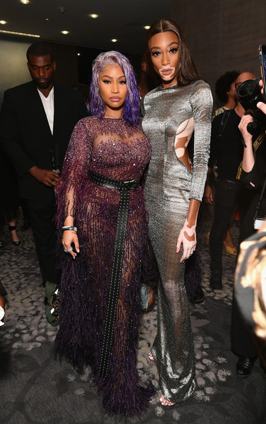Nicki Minaj worked a sheer, beaded purple gown by Pamella Roland at the 2018 Fashion Media Awards.